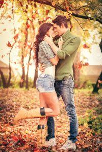 couple-in-love-in-park-standing-on-fallen
